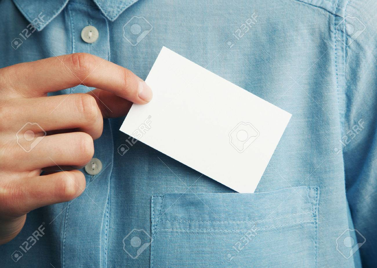 Young business man who takes out blank business card from the pocket of his shirt. Horizontal - 51532885