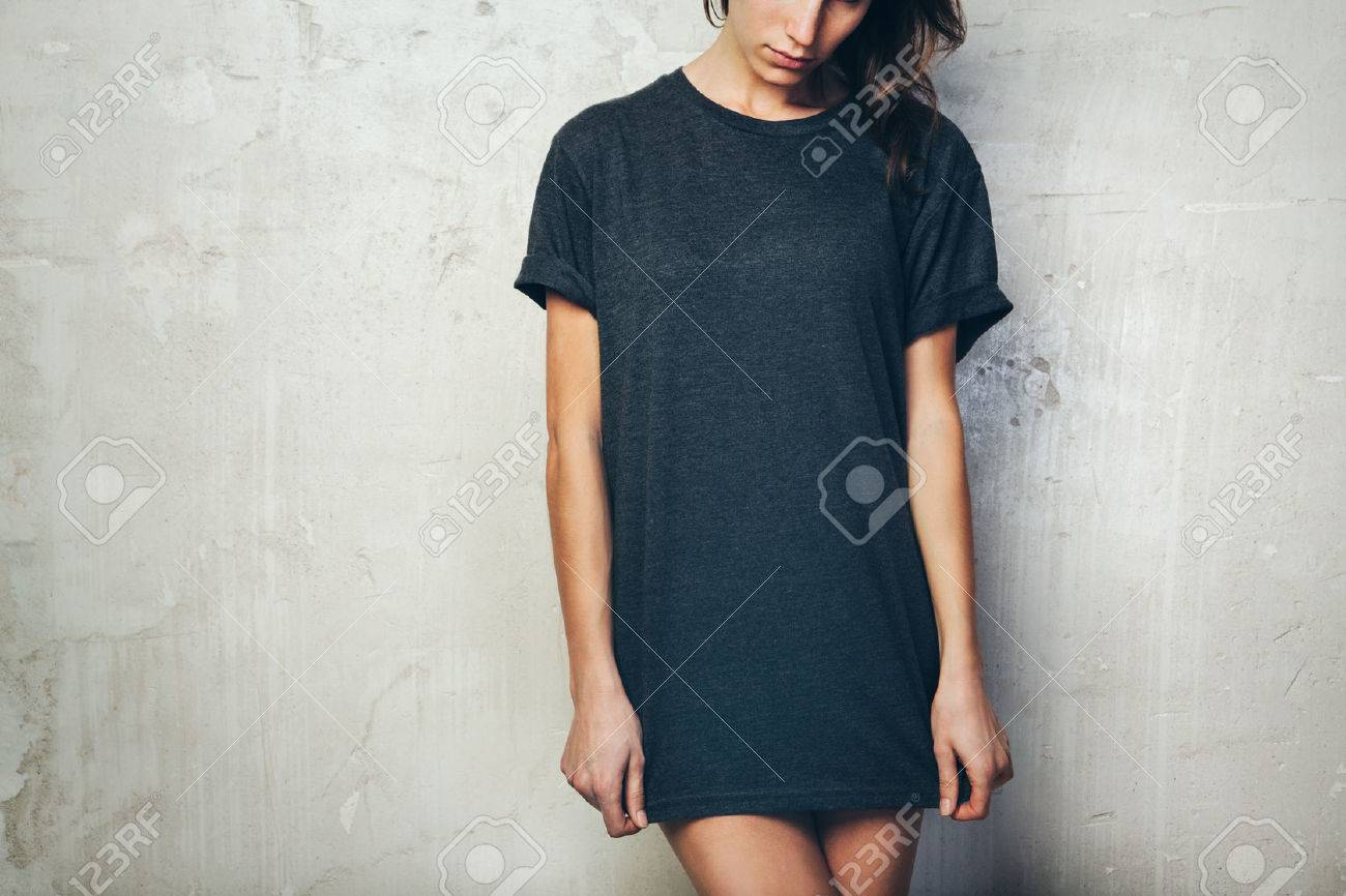 Young girl wearing blank black t-shirt. Concrete wall background - 52905725
