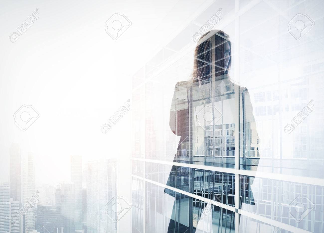 Photo of businesswoman. Double exposure, city on the background. Blurred background - 52906023
