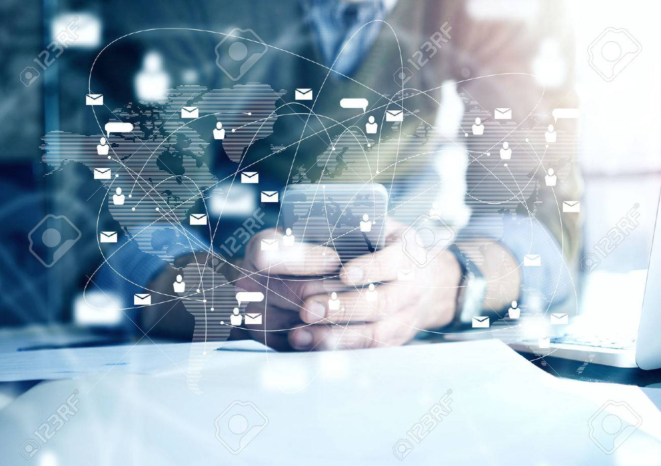 Business concept, businessman using smartphone. Architectural plans on the table. Digital connection interface Stock Photo - 52906437