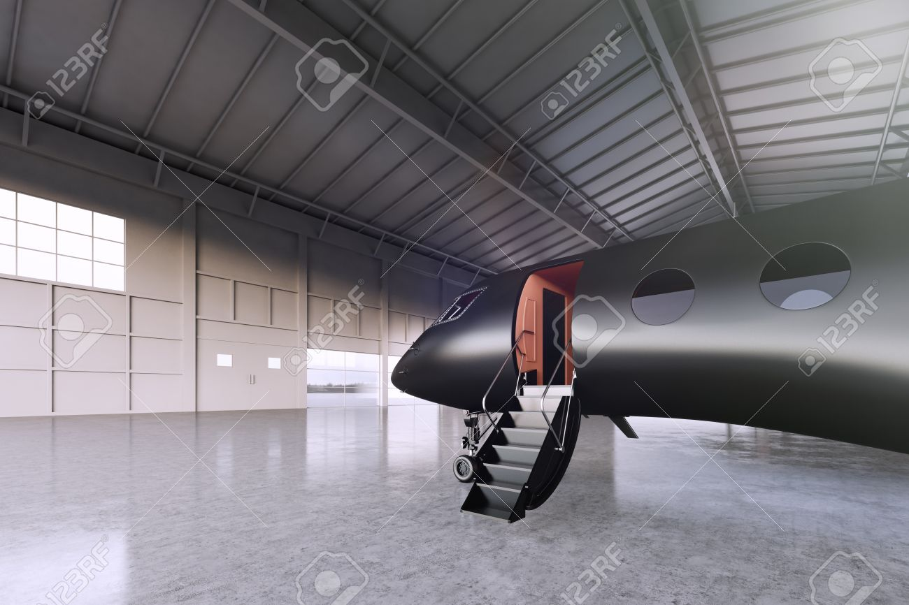 551ad1d061 Photo of Black Matte Luxury Generic Design Private Jet parking in hangar  airport. Concrete floor