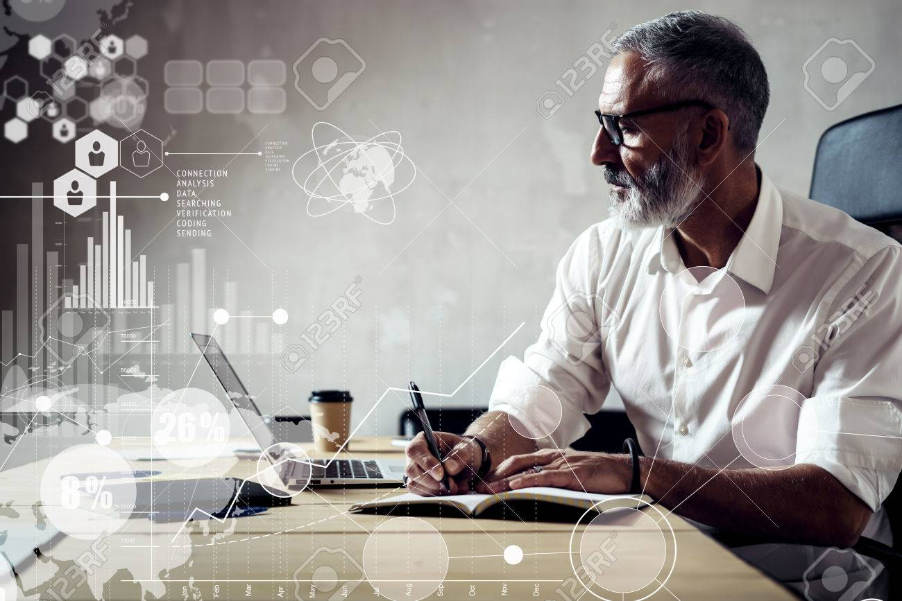 Concept of digital screen with global virtual icon,diagram, graph interfaces.Adult successful businessman wearing a classic glasses and working with laptop at the wood table in modern loft.Horizontal - 65933496