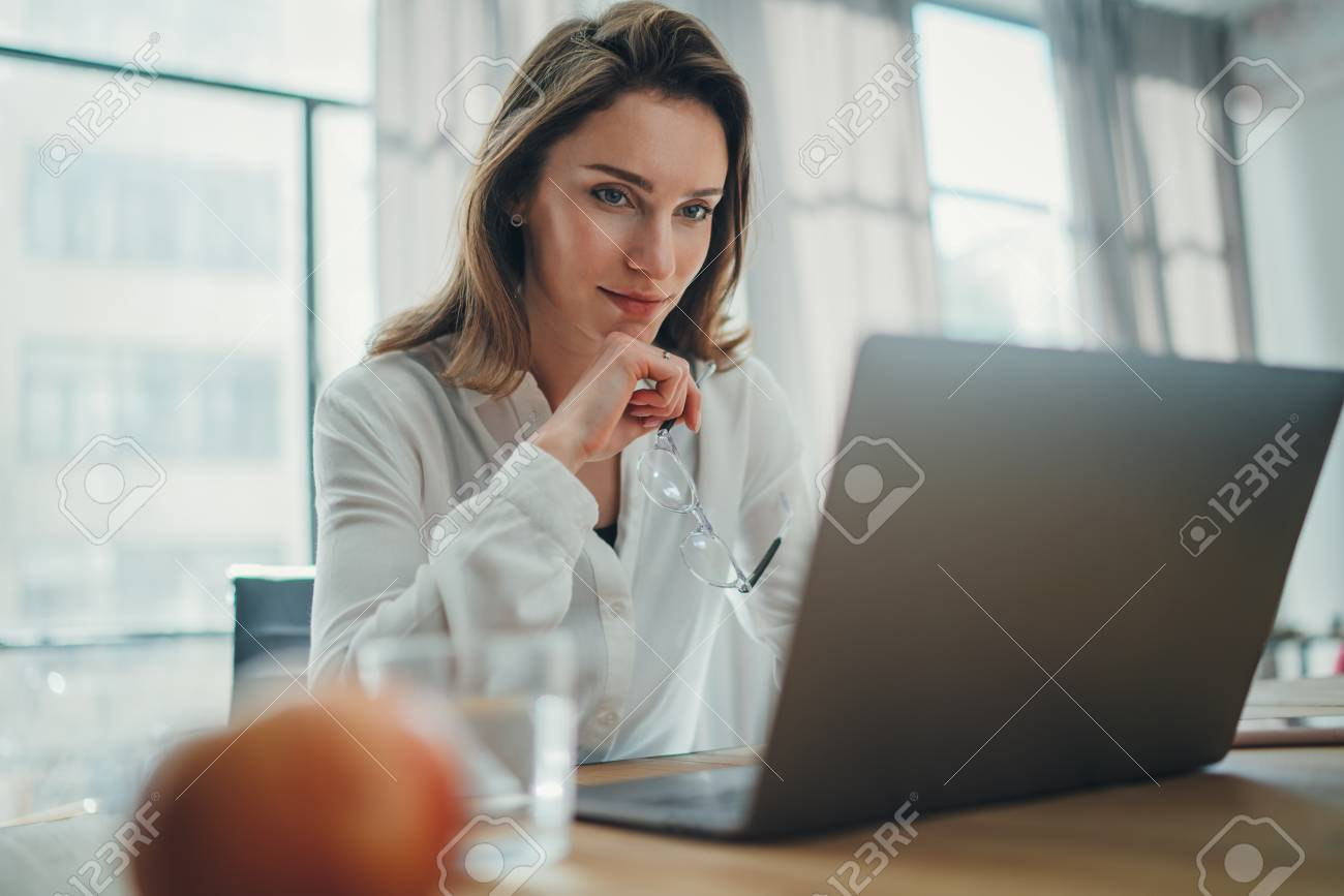 Handsome businesswoman working on laptop at her workplace at modern office.Blurred background. - 121282521