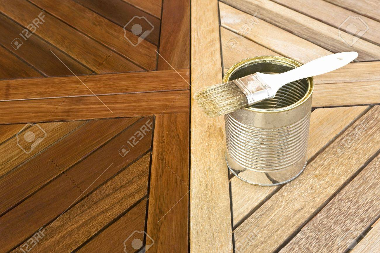 Staining Wooden Table. Before And After Stock Photo   12584307