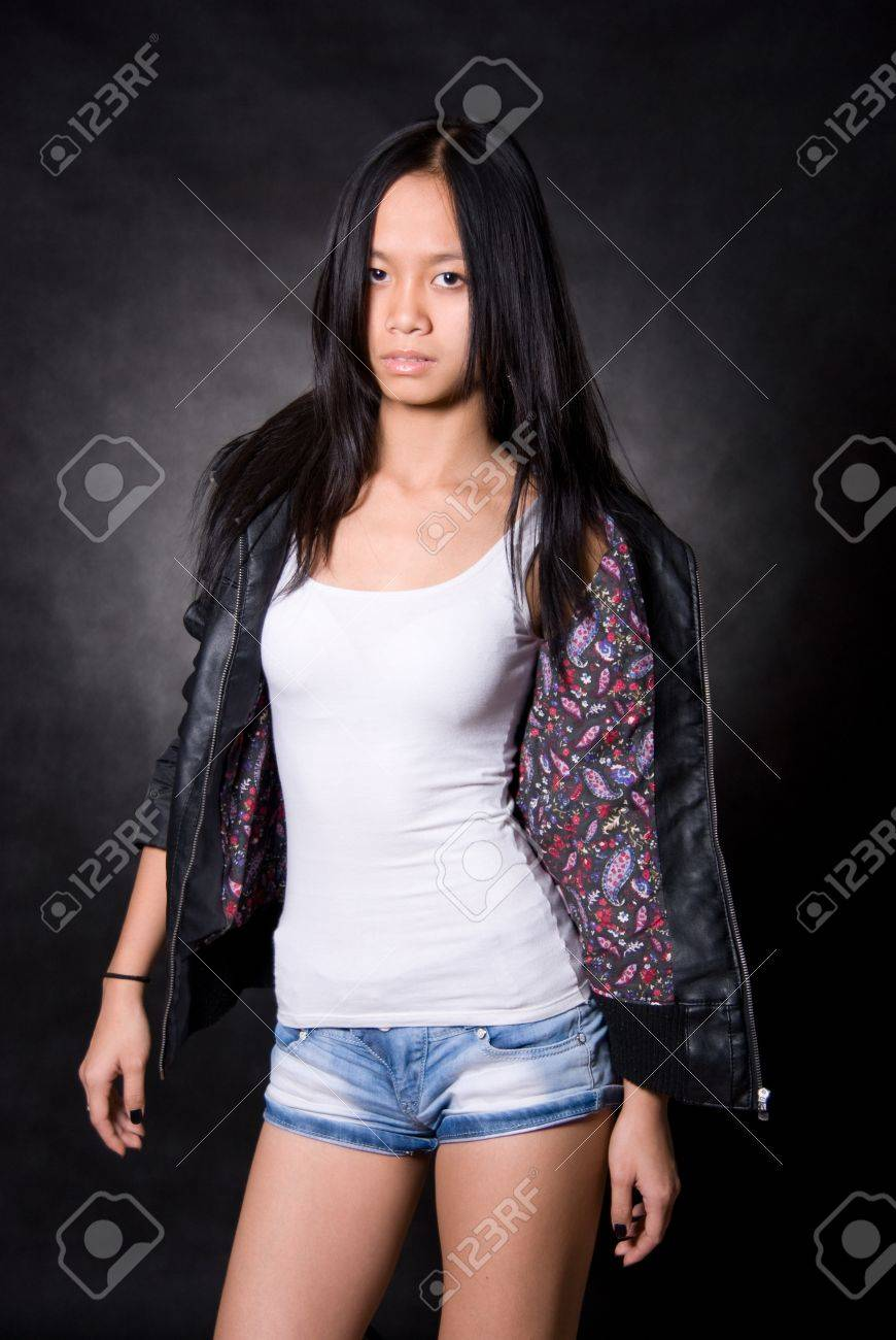 Portrait of Asian girl in a leather jacket on a black background Stock Photo - 12064504