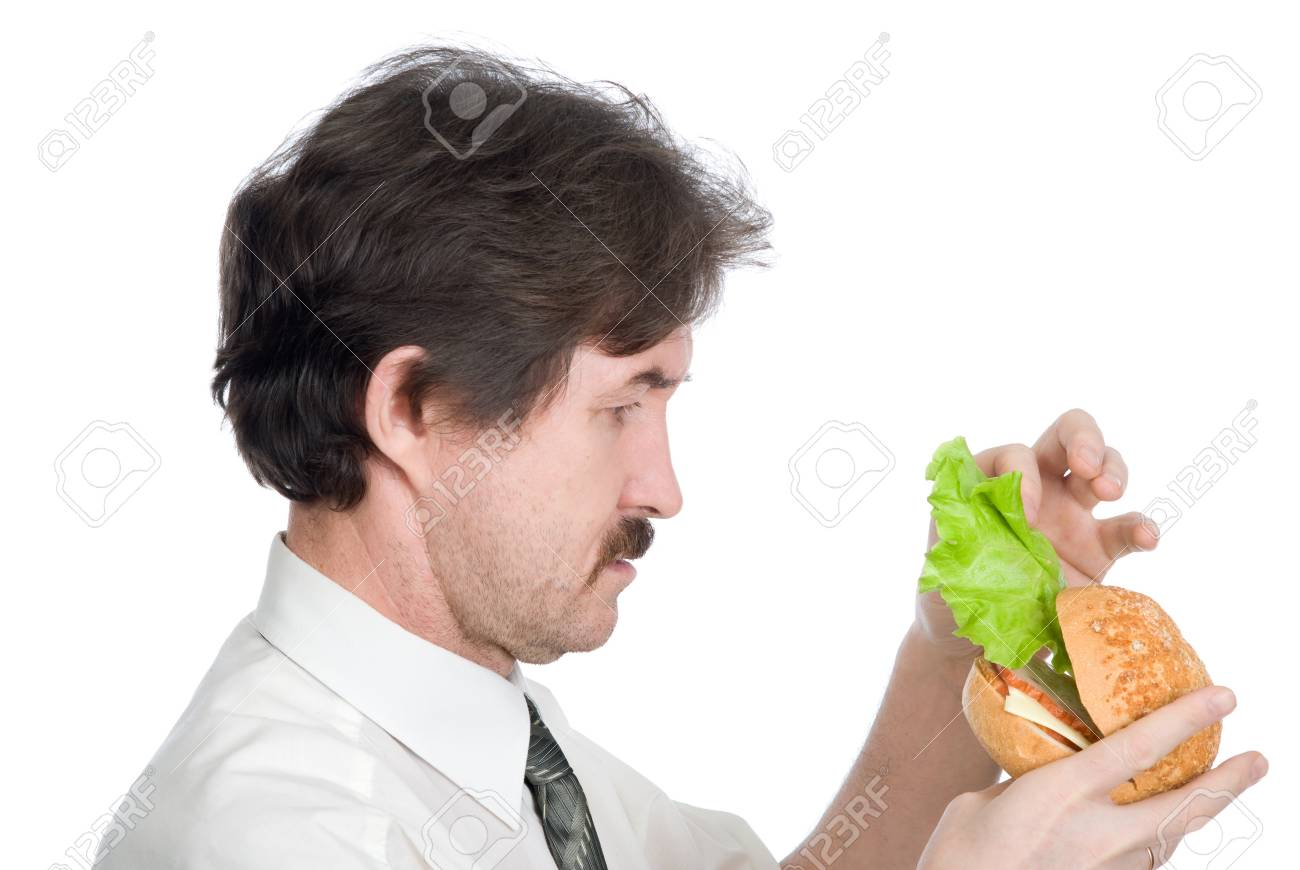 Man will get from hamburger sheet salad. Isolated on white background Stock Photo - 12358476