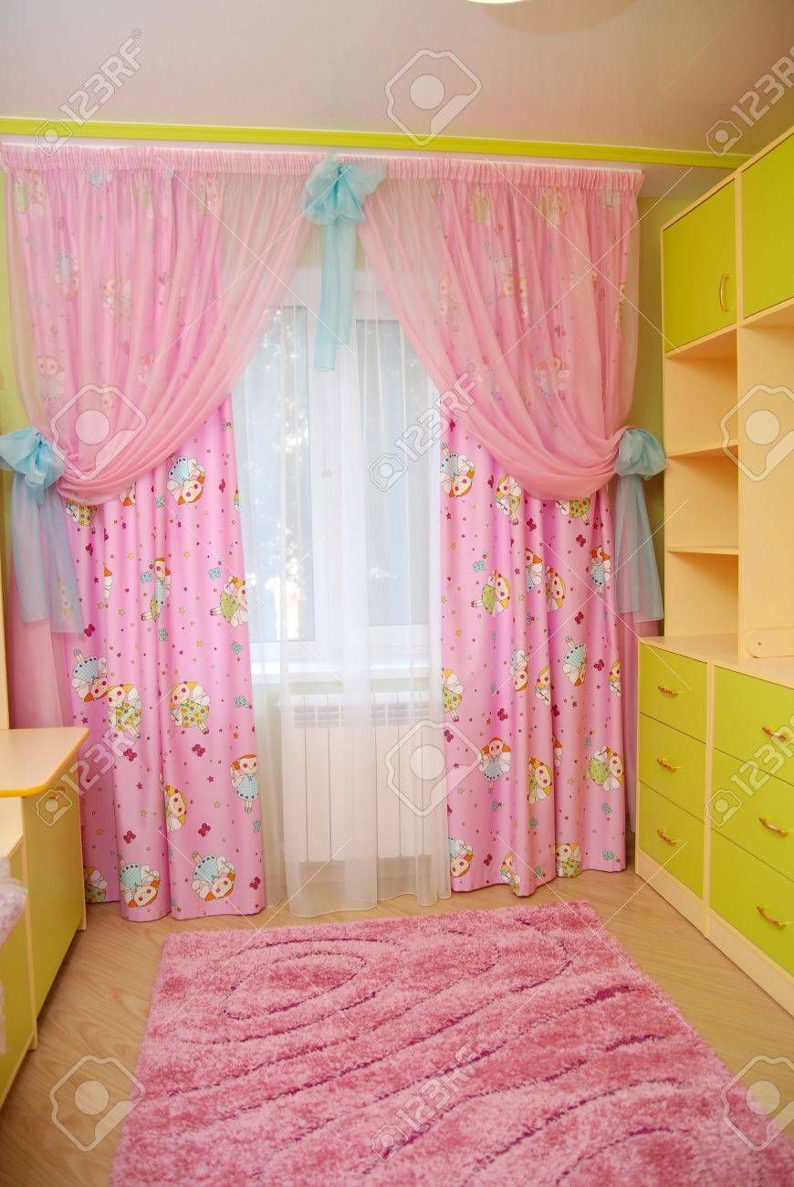 Pink Curtains In A Nursery Stock Photo