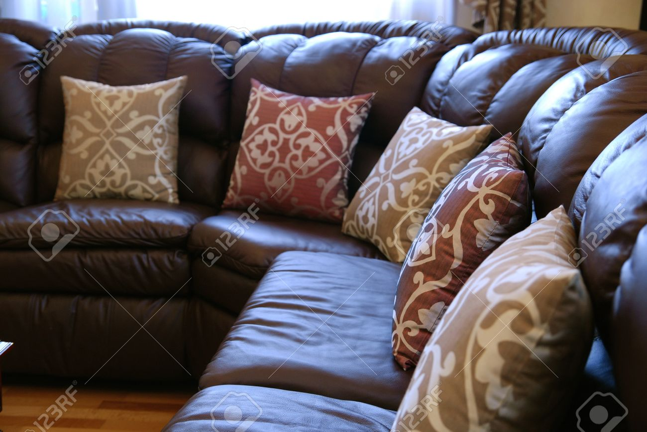 Pillows A Brown Leather Sofa Stock Picture And Royalty