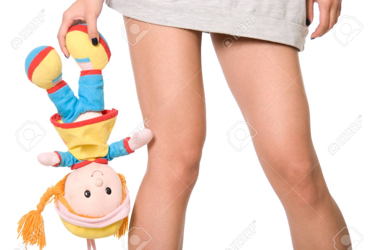 Doll hangs on a hand at girl.Isolated on white background Stock Photo - 14608349