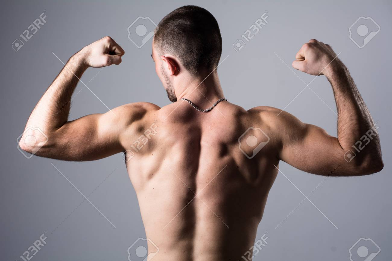 495a9f84d7261 Portrait of a handsome muscular young man from the back. Shot..