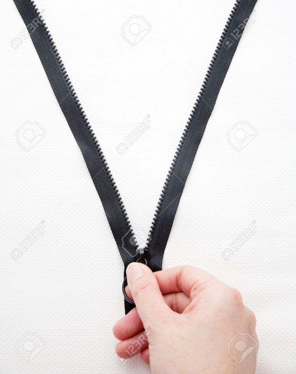 Hand unzip on the white background