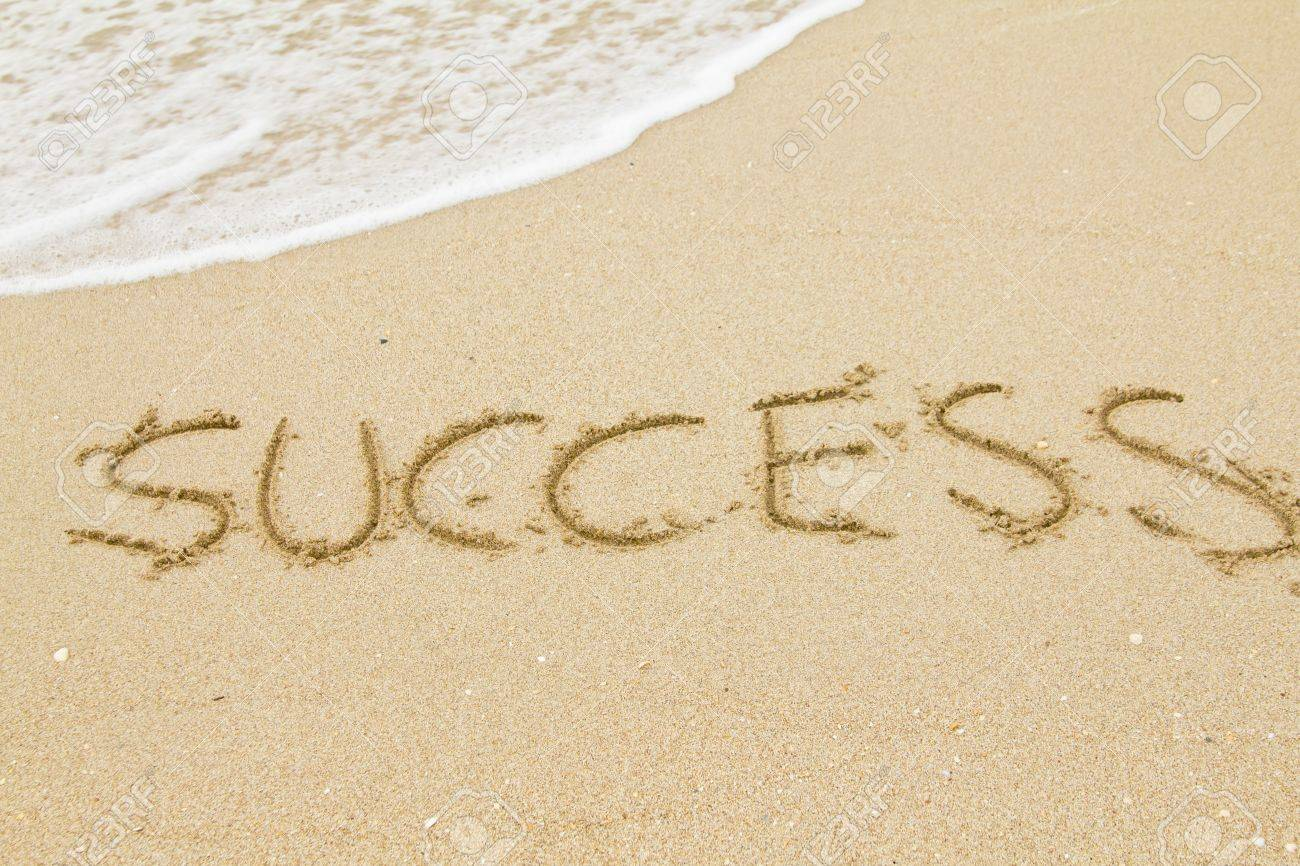 word success on the sand and sea wave stock photo picture and