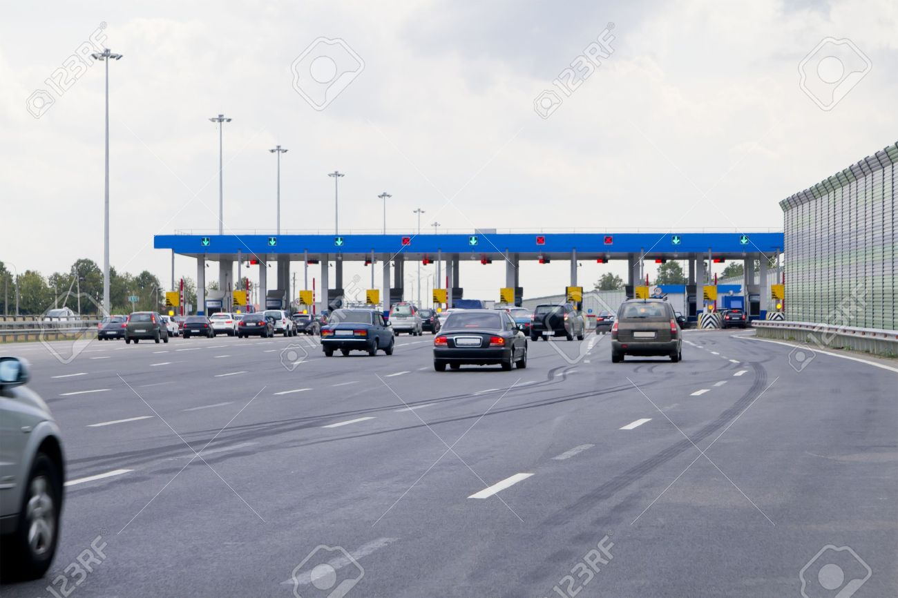 gate with barriers by toll road on the highway