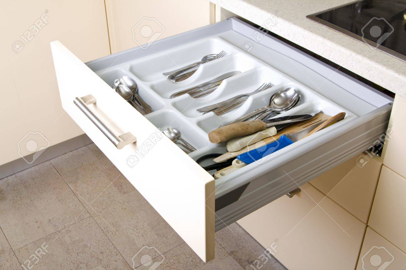 Open Organized Kitchen Drawer With Utensils Stock Photo, Picture And ...