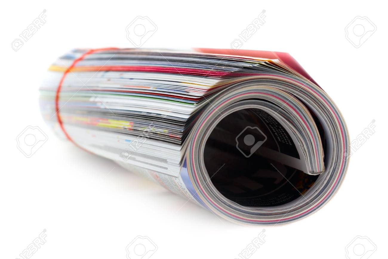 shot of the magazine roll (Shallow DOF) on a white background with pretty shadow - 784766