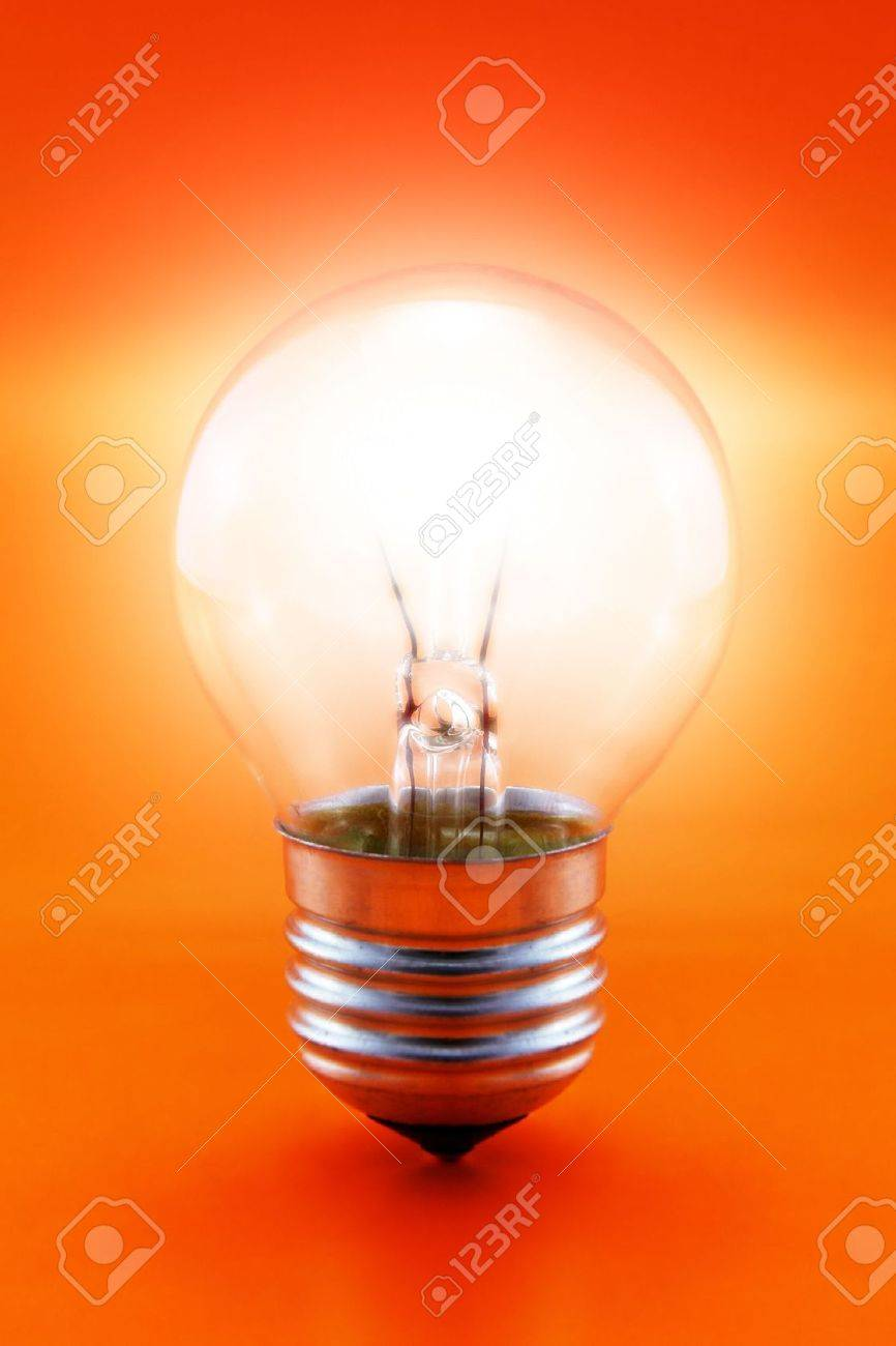 close-up of a glowing light bulb on a red background - 1192499