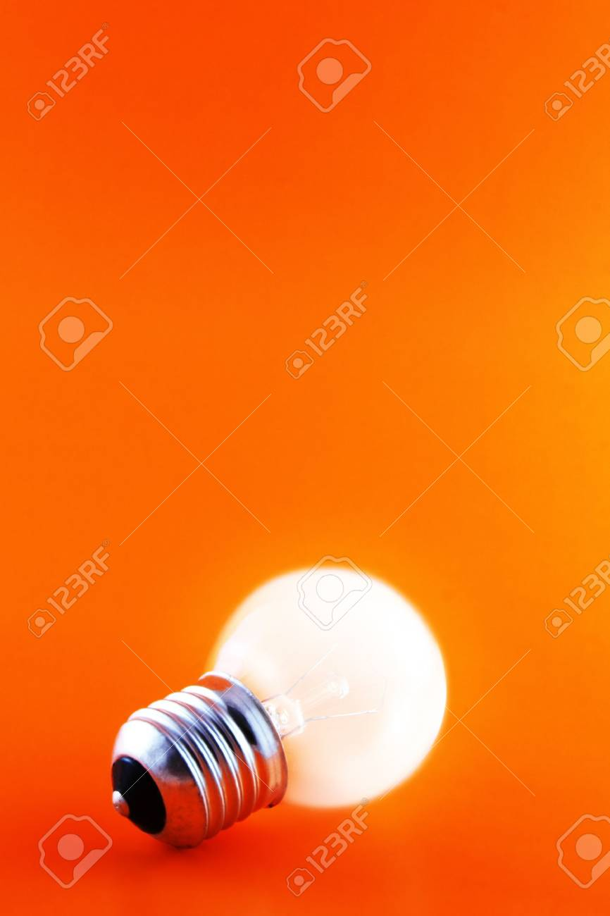 glowing light bulb on a red background with copyspace - 1192517
