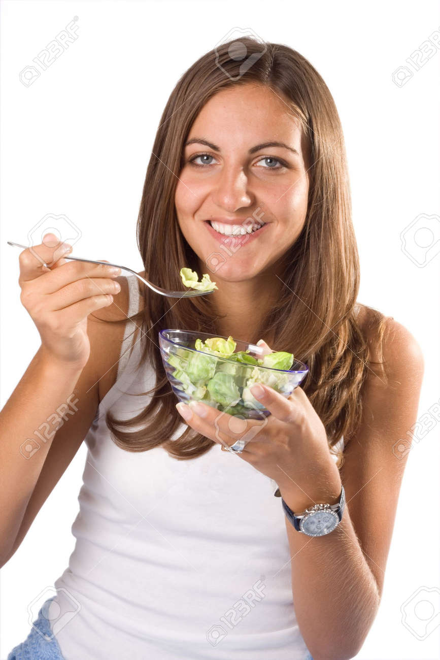Portrait of young happy smiling woman eating salad Stock Photo - 3844961