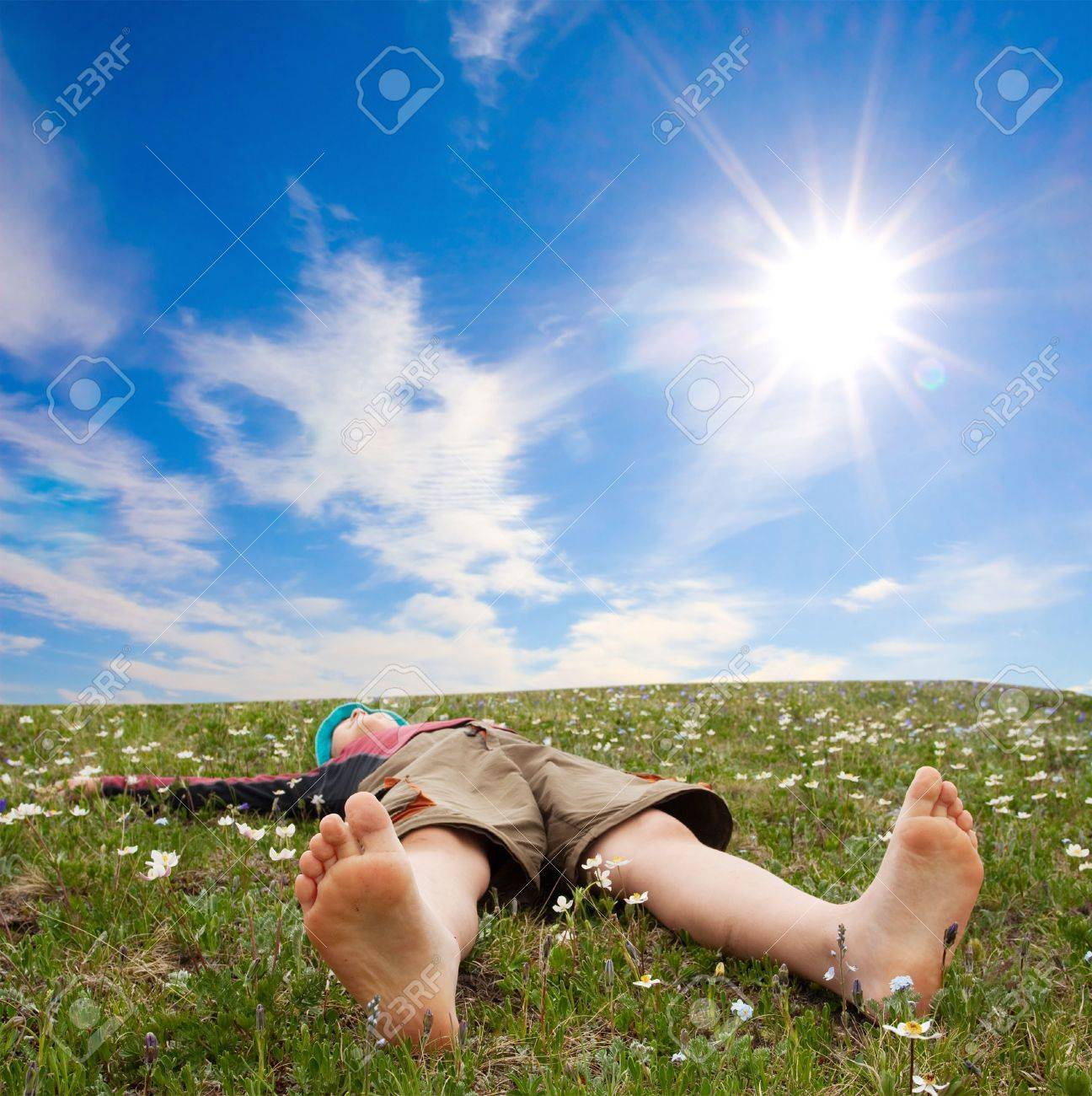 Hiker lies on meadow in mountains Stock Photo - 5575507