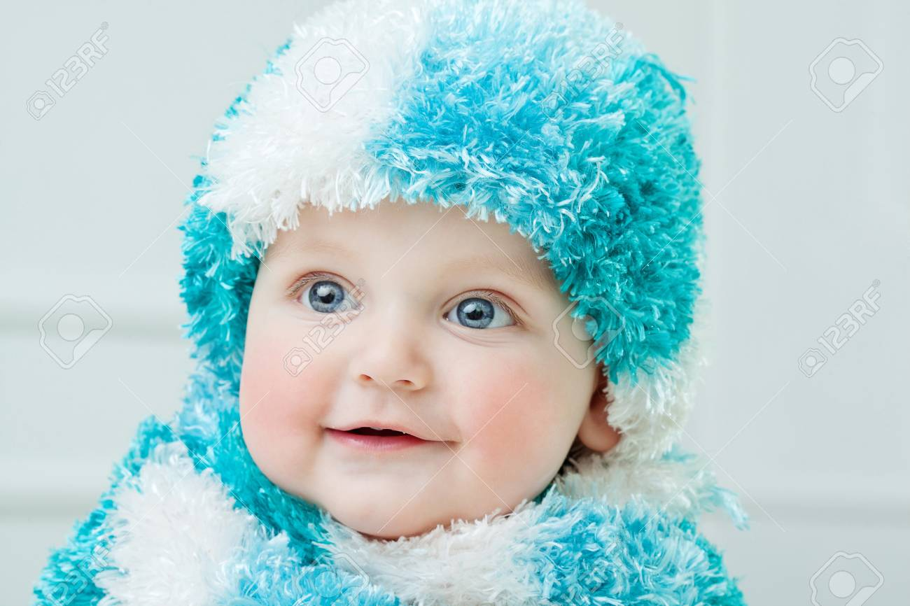 c2838952411b Cute Baby At Winter Background Stock Photo