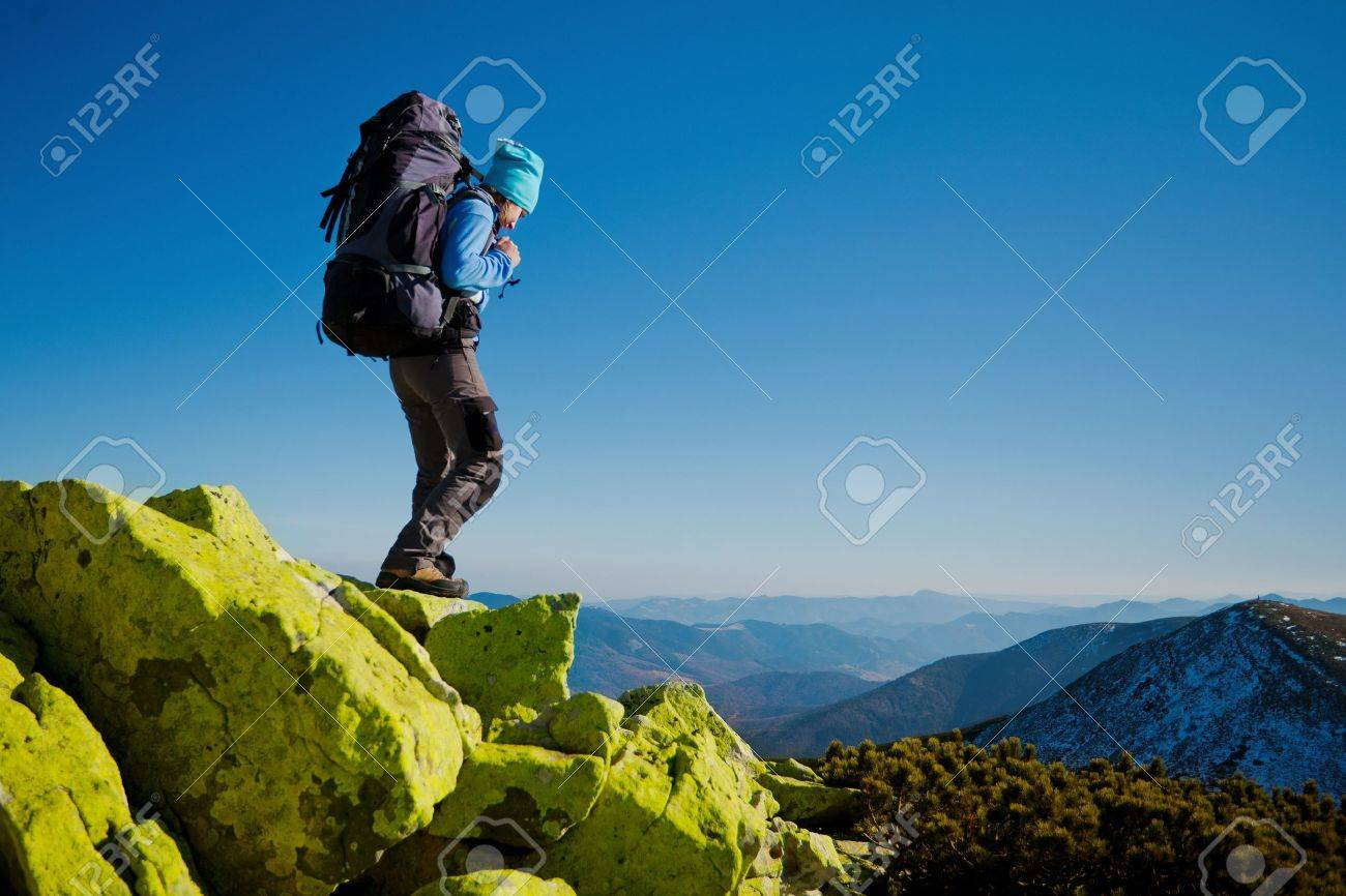 Hiker walking in autumn mountains  Caucasian model outdoors in nature Stock Photo - 17694291