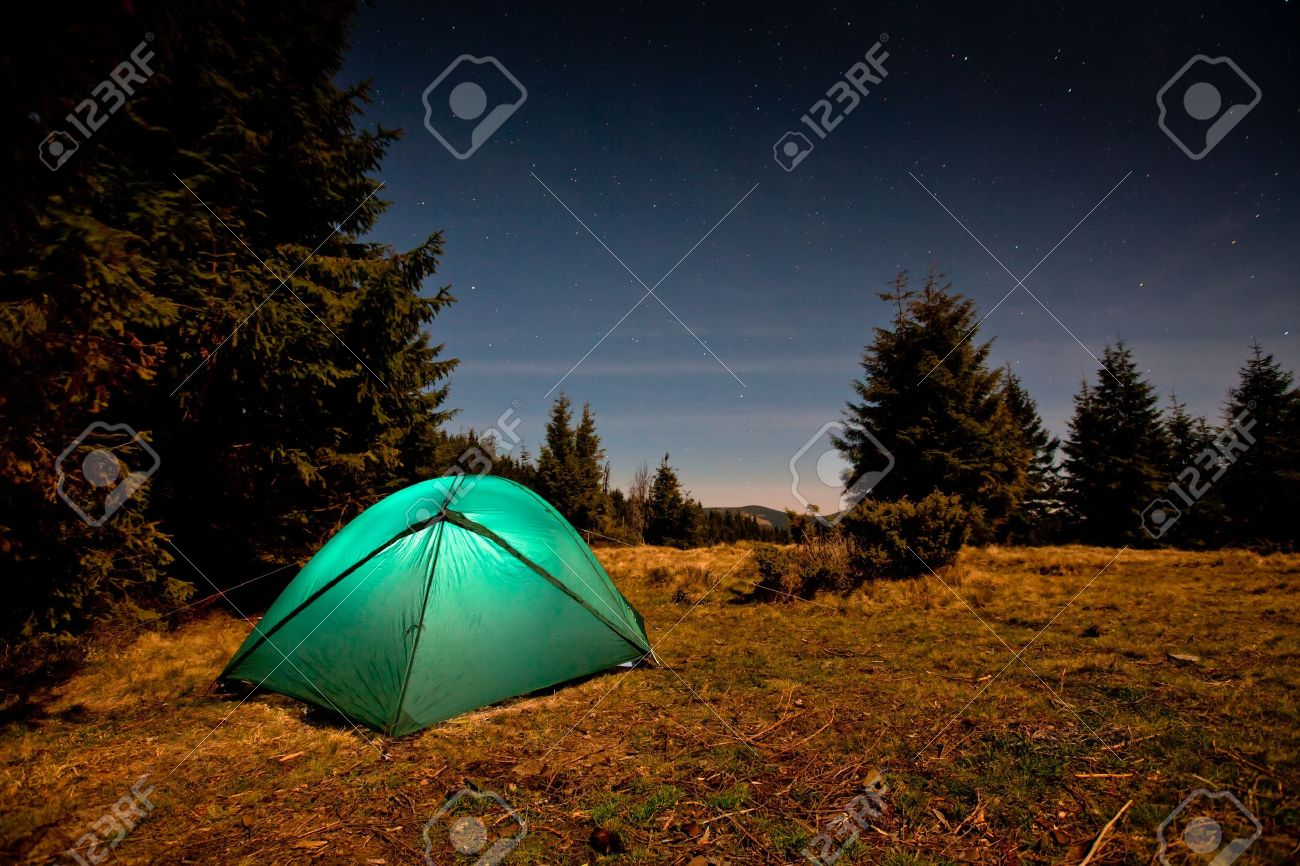 Tent Illuminated With Light In Night Forest Stock Photo Picture And
