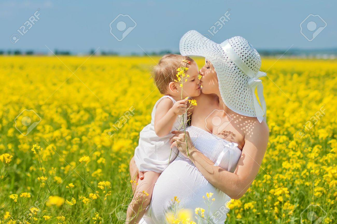 Pregnant mother and her daughter have fun outdoor Stock Photo - 19866101