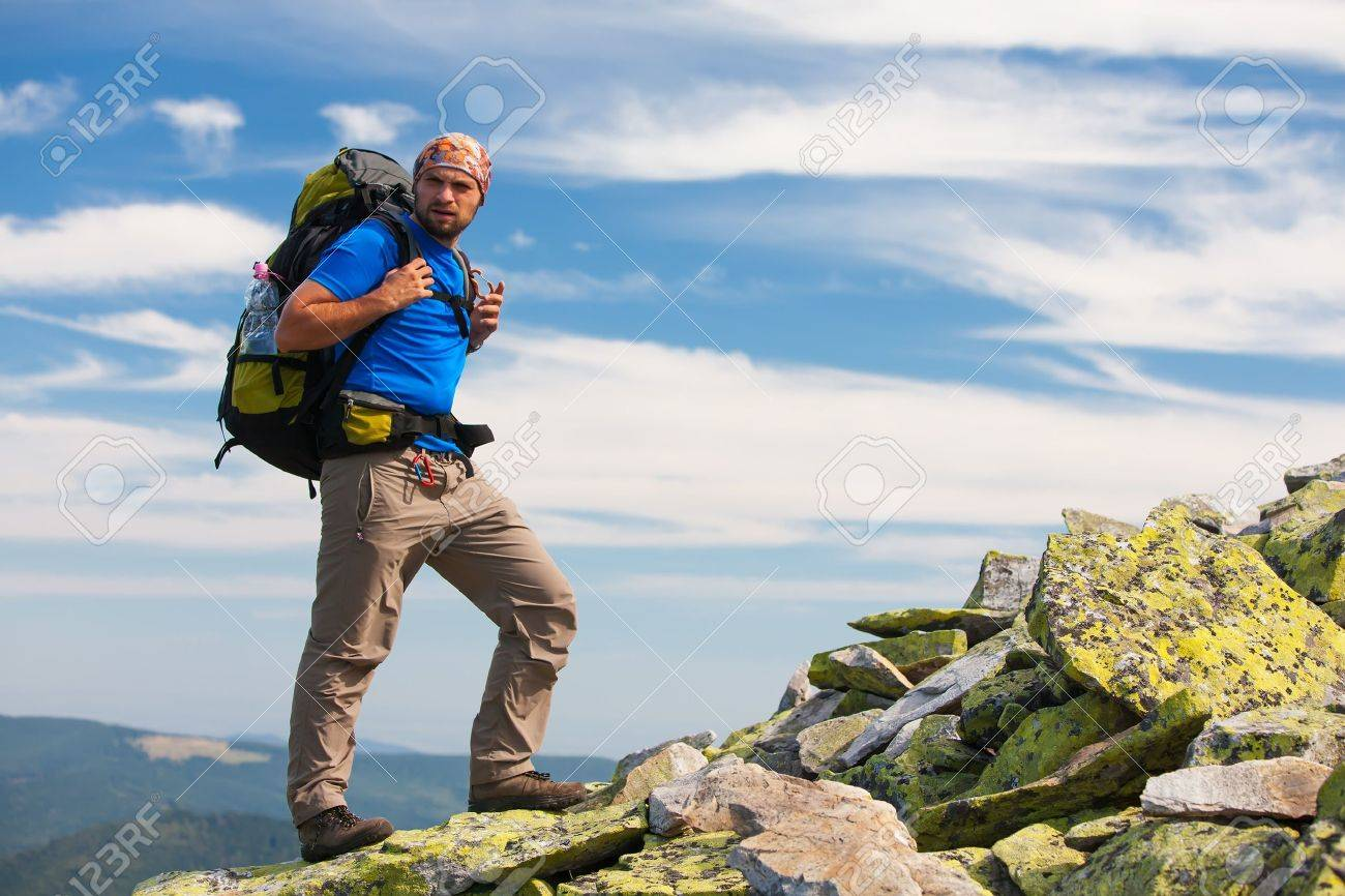 Hiker makes his way in Carpathian mountains - 22011338