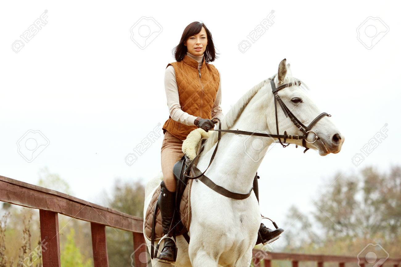 Woman jockey is riding the horse outdoor - 31364381