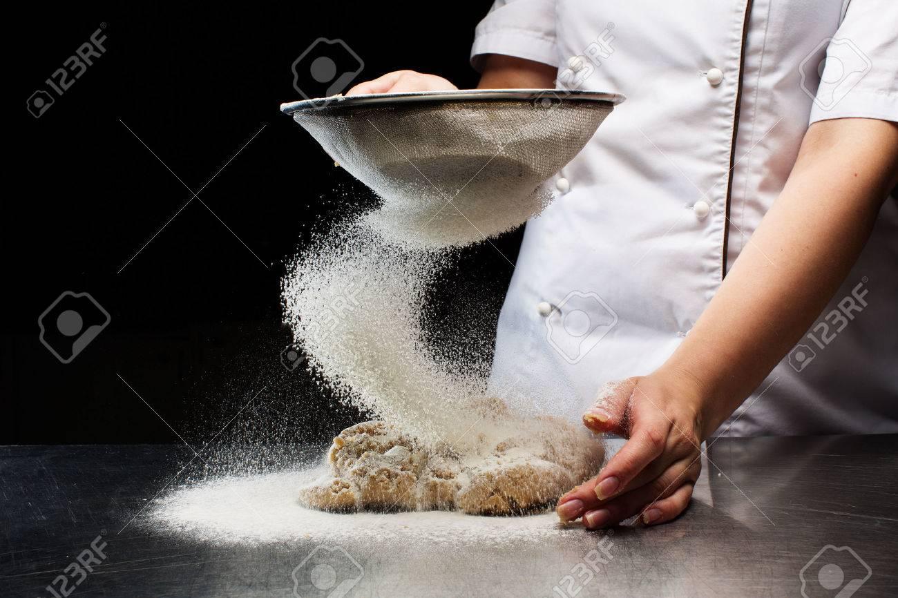 Woman hands kneading dough. - 62204447