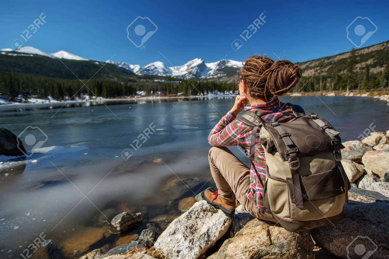 Hiker in Rocky mountains National park in USA - 120574860