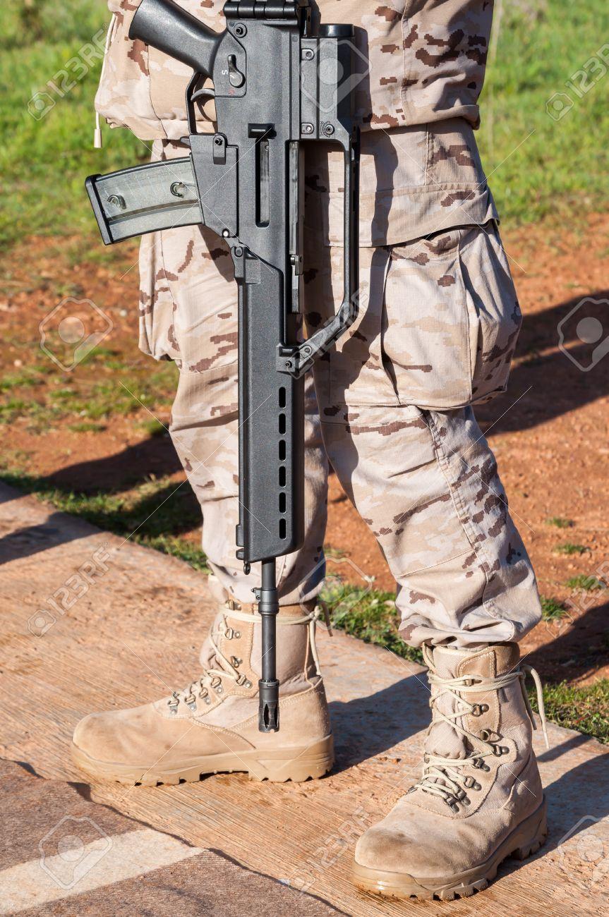 HK G36 assault rifle on shoulder of a soldier