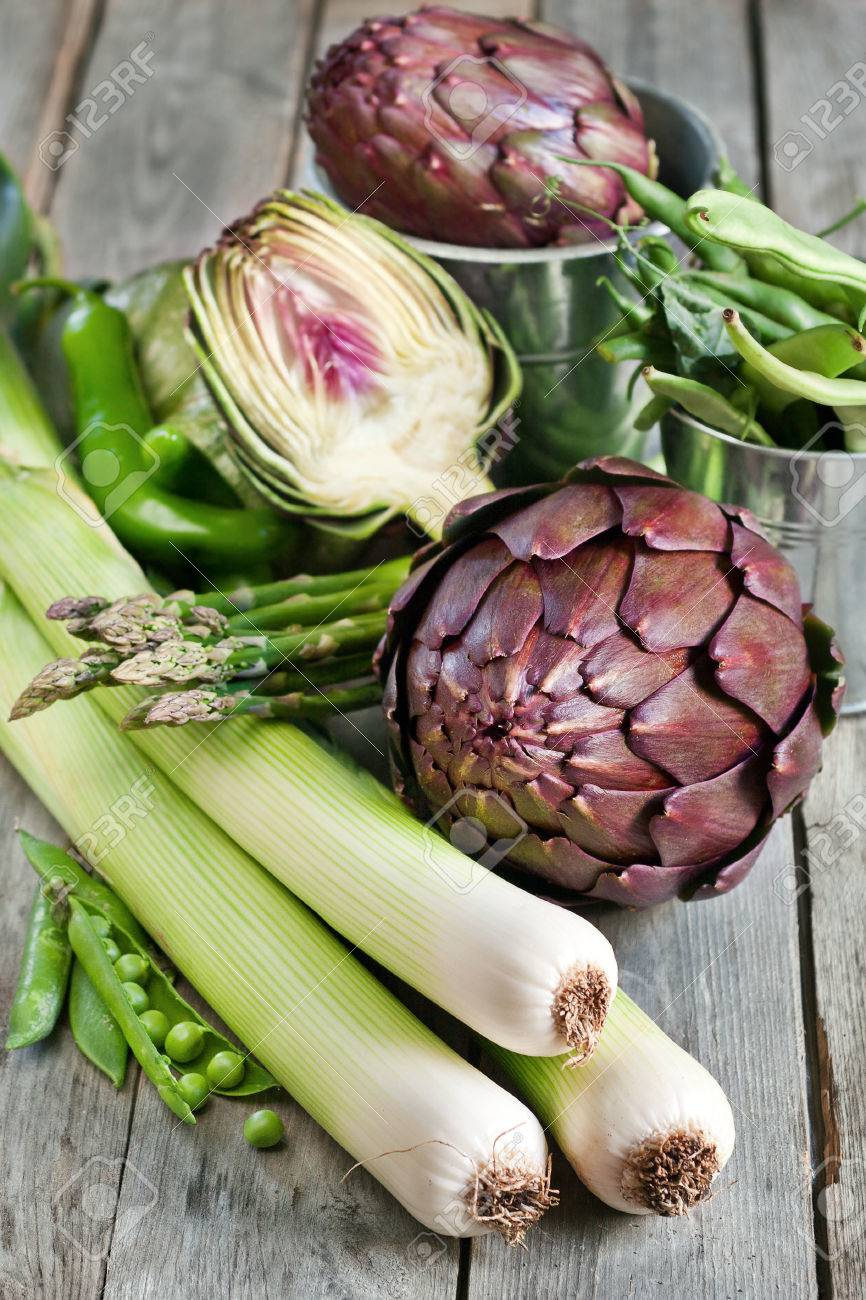 Artichoke, leek, beans, pea, asparagus and green hot pepper on old wood table - 27364309