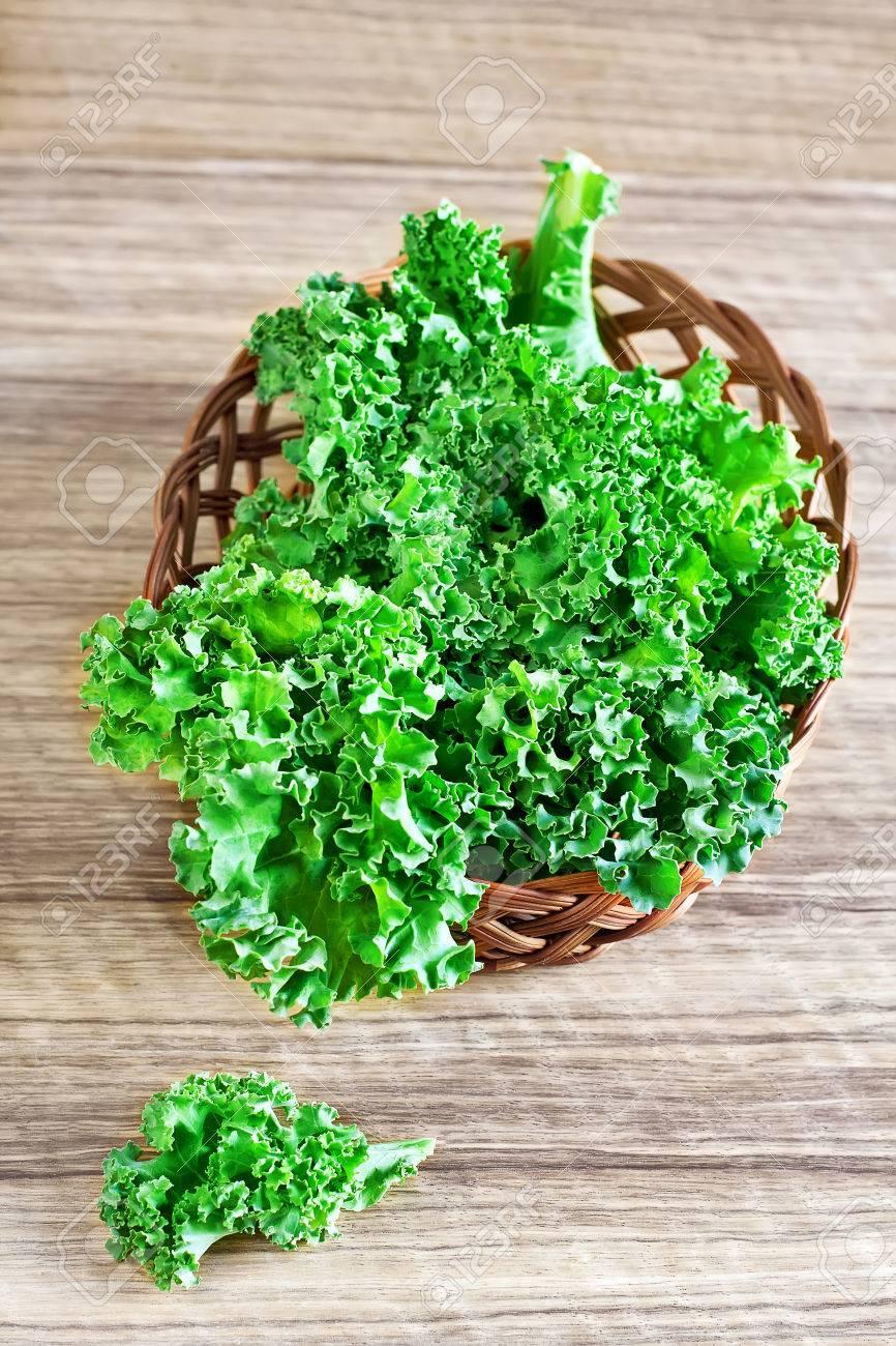 Fresh green kale leaves in basket. Selective focus. - 27910802