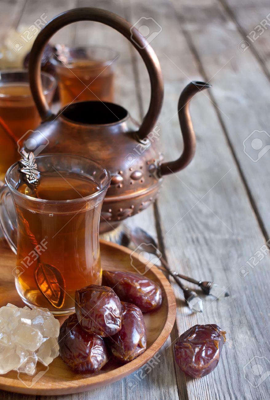 Traditional arabic tea with dry madjool dates and rock sugar nabot. Selective focus. Copy space background. - 29466744
