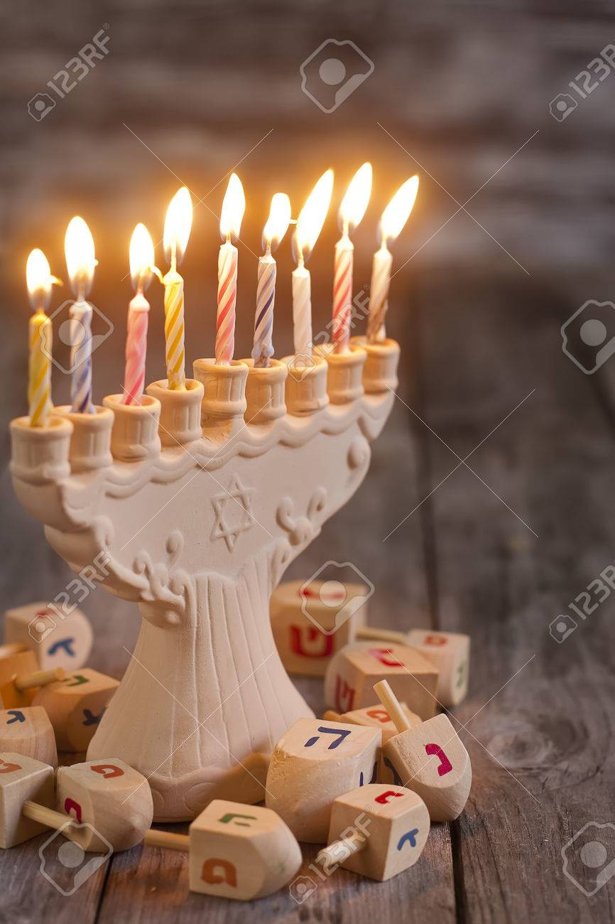 Jewish holiday hannukah symbols - menorah and wooden dreidels. Copy space bacground. - 33455494