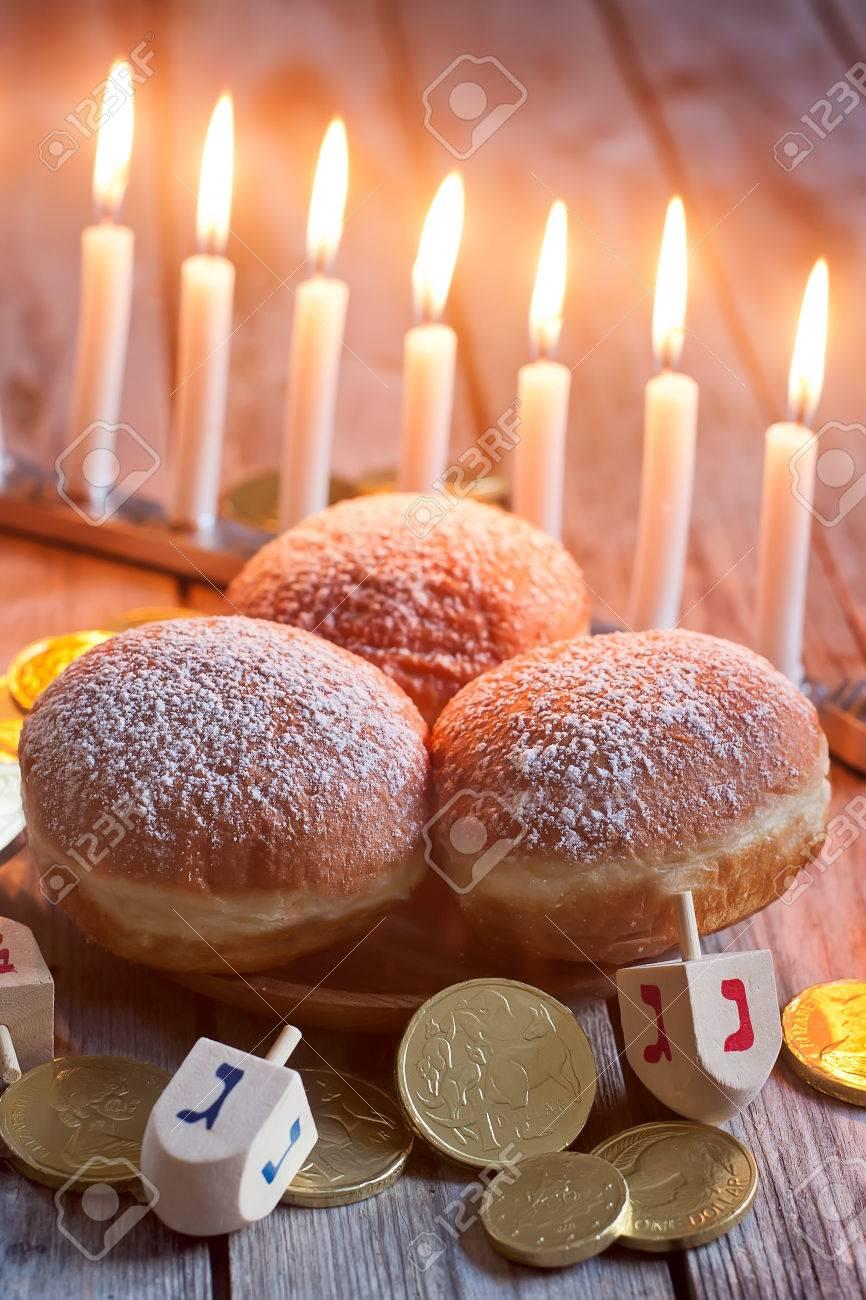Jewish holiday hannukah symbols - menorah, doughnuts, chockolate coins and wooden dreidels. - 35072828