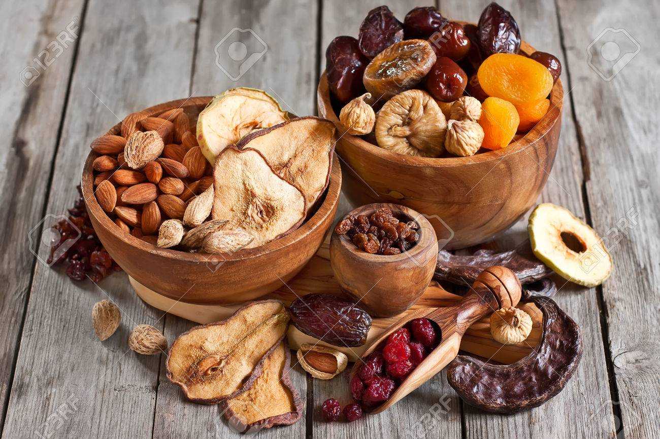 Mix of dried fruits and almonds - symbols of judaic holiday Tu Bishvat. - 35113067