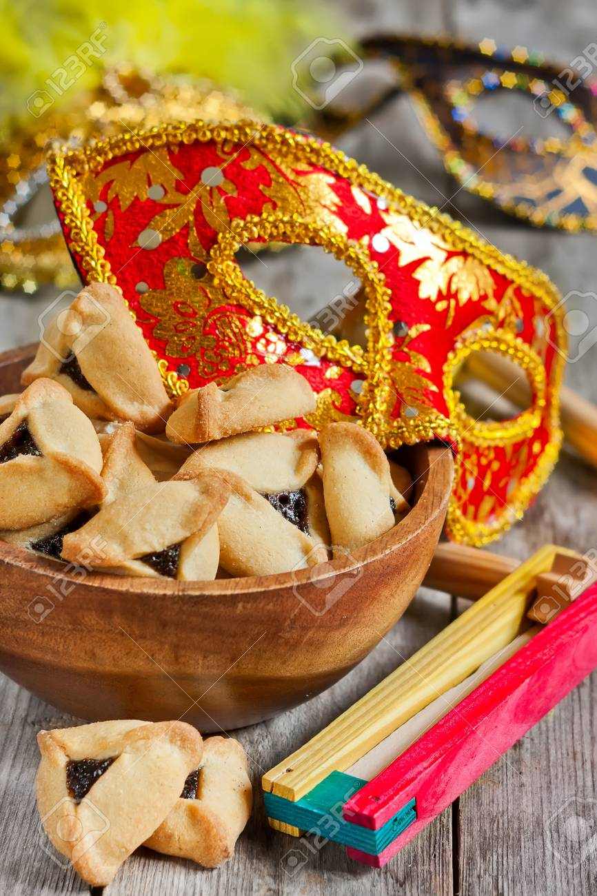 Hamantaschen cookies or Haman's ears, noisemaker and carnival masks for Purim celebration (jewish holiday). - 36978310
