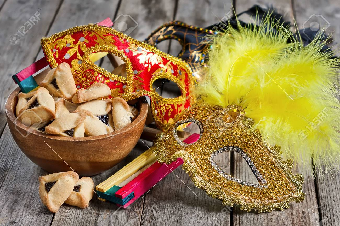 Hamantaschen cookies or Haman's ears, noisemaker and carnival masks for Purim celebration (jewish holiday). - 36978311
