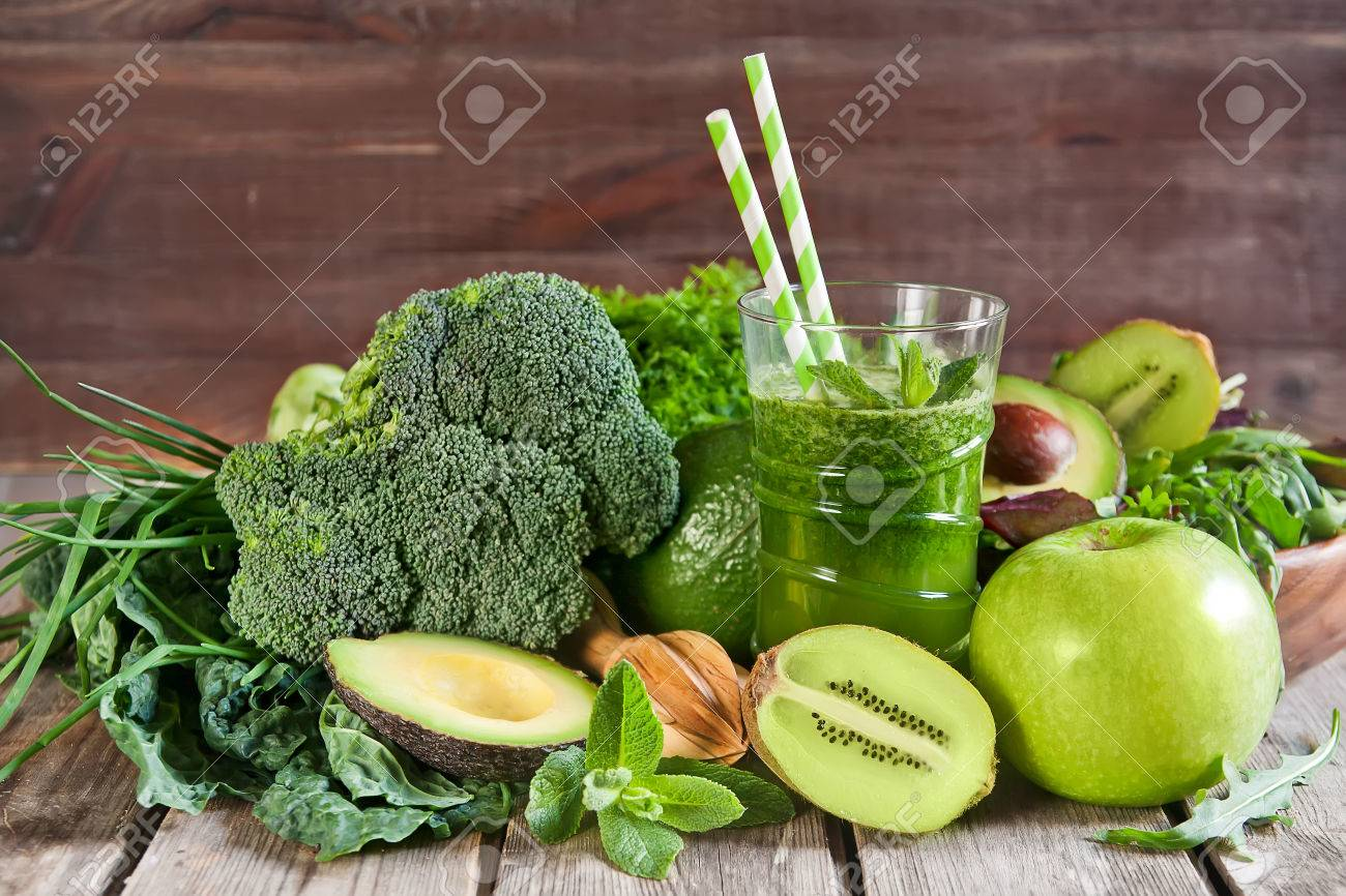 Green detox smoothie with raw vegetables and fruits - 38625938