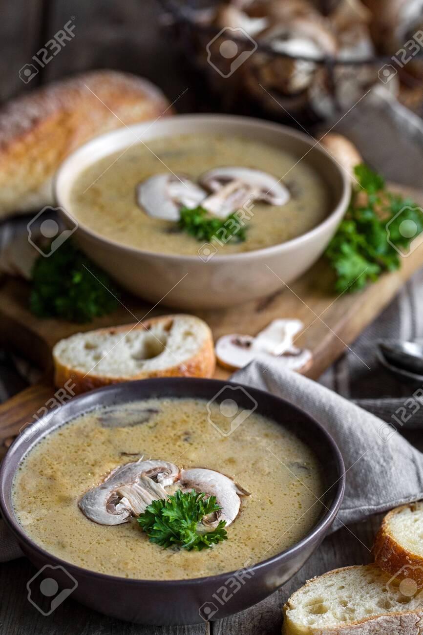 Delicious homemade mushrooum soup puree with portobello and wild mushrooms on rustic table - 138759381