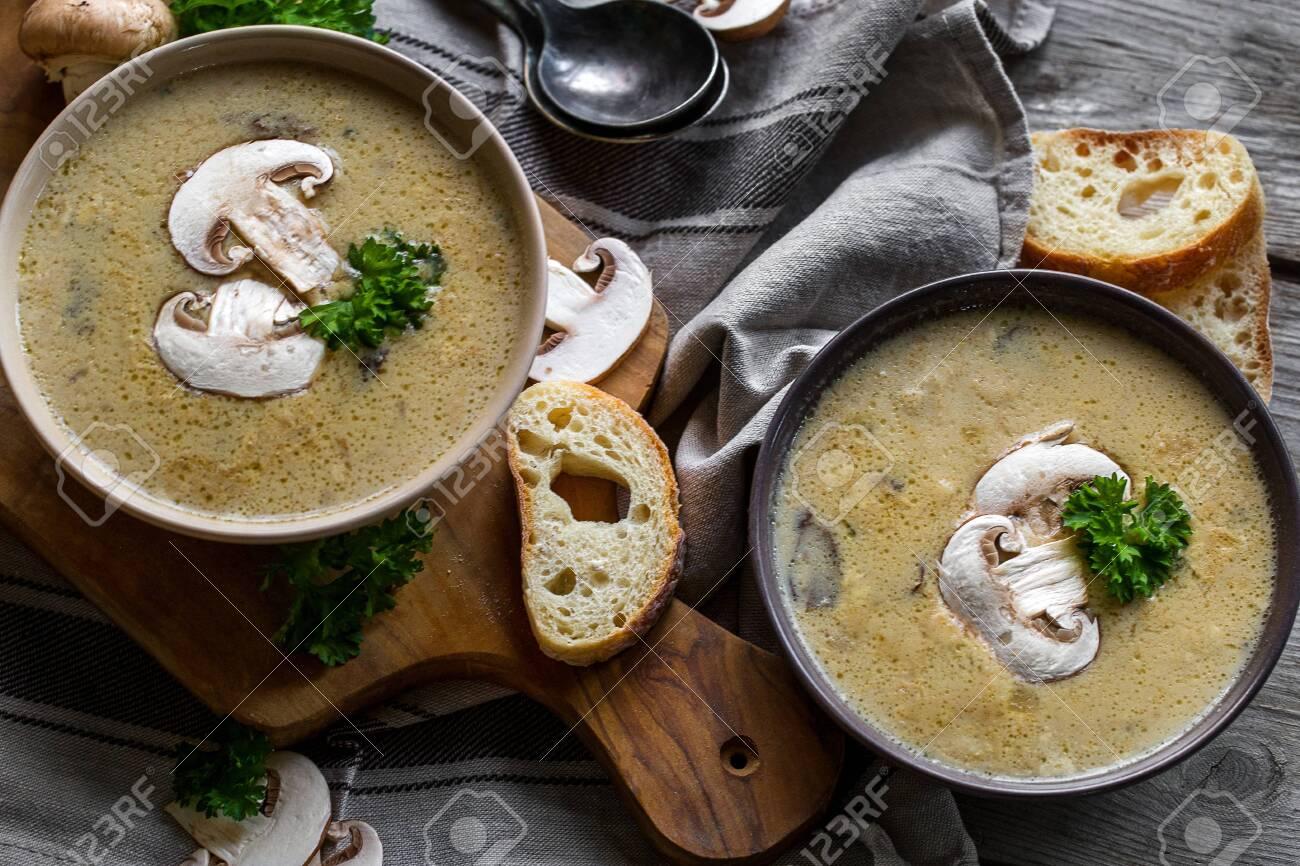 Delicious homemade mushrooum soup puree with portobello and wild mushrooms on rustic table - 138759525