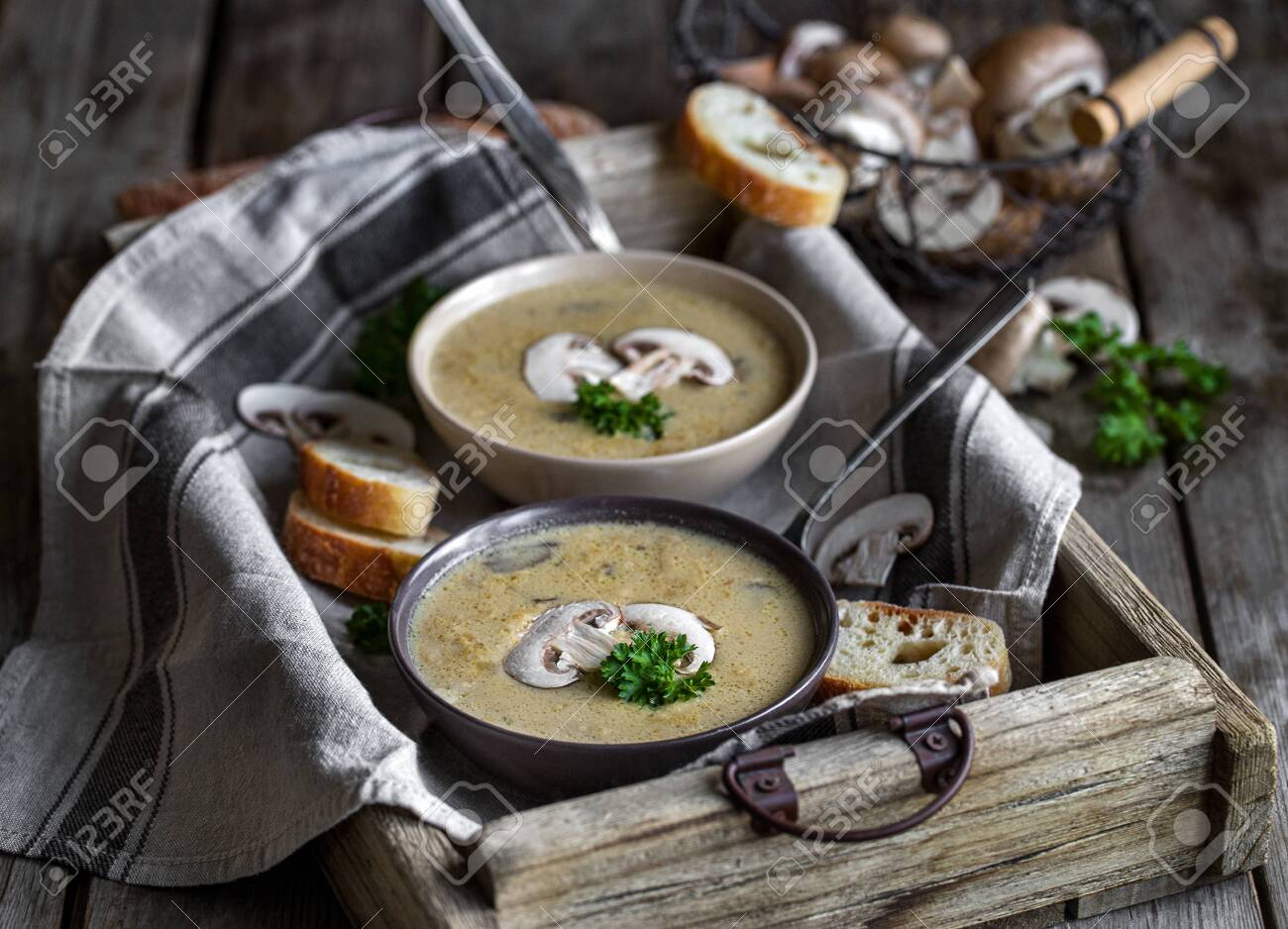 Delicious homemade mushrooum soup puree with portobello and wild mushrooms on rustic table - 138759171