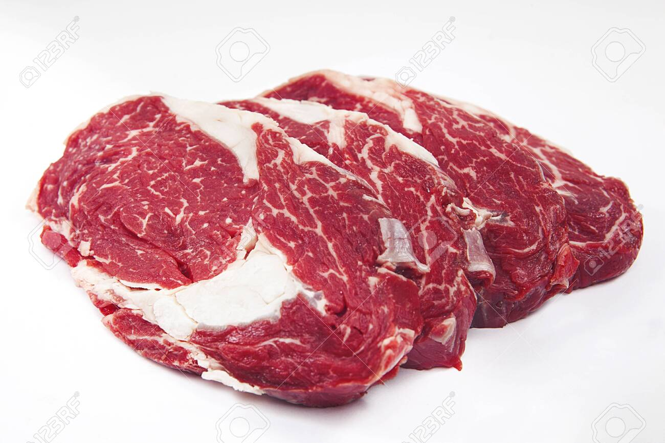 Fresh raw beef steak on wooden background. Roast beef. - 141067386