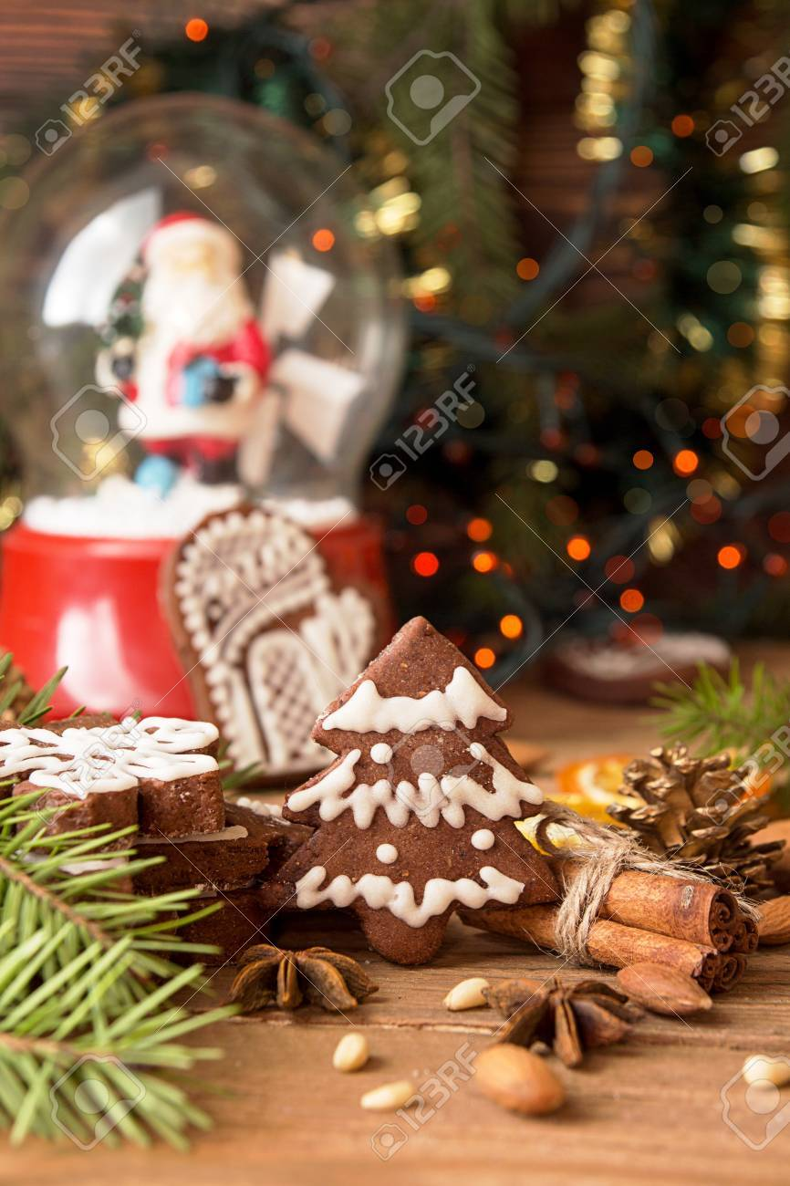 Christmas Gingerbread Cookies Against Background Glass Sphere
