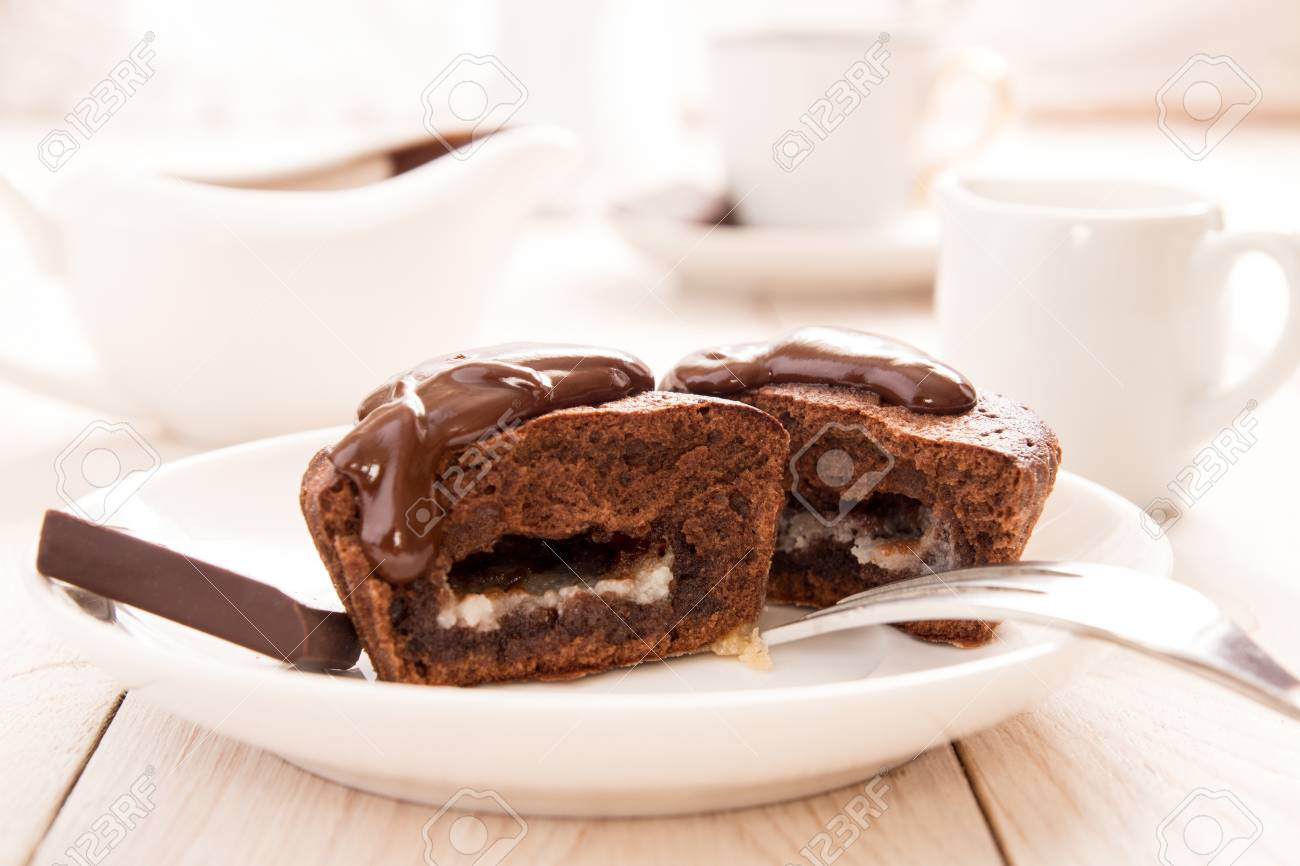chocolate french dessert cake mi-cuit on white plate over on.. stock