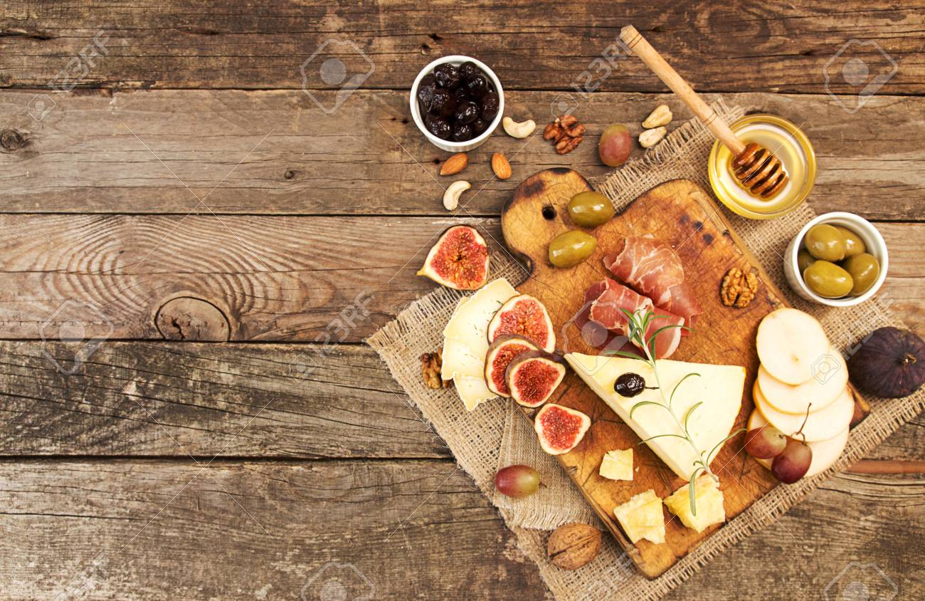 Food composition with cheese plate with cheese dry meats various fruits and nuts. & Food Composition With Cheese Plate With Cheese Dry Meats Various ...