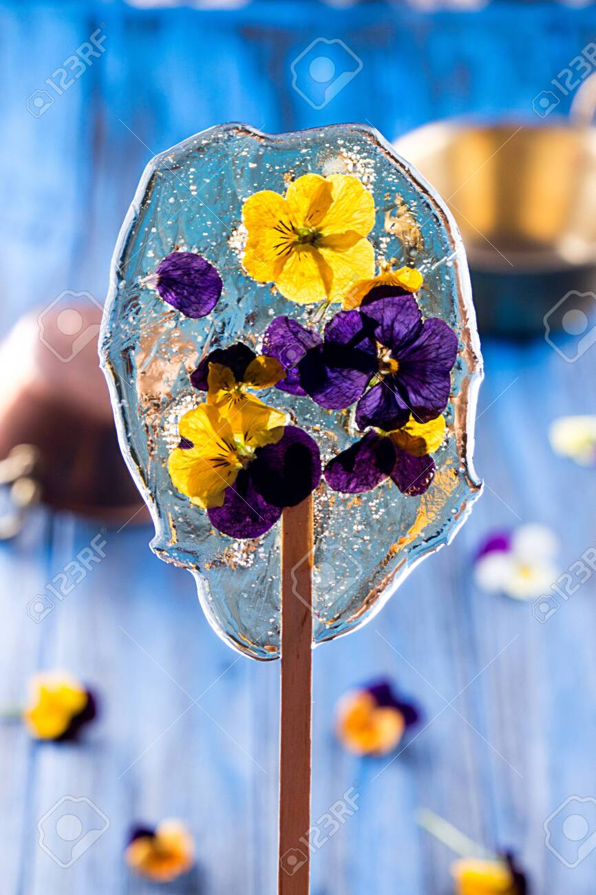 Beautiful Lollipop Caramel With Edible Violet Flowers Over On Stock Photo Picture And Royalty Free Image Image 145761112