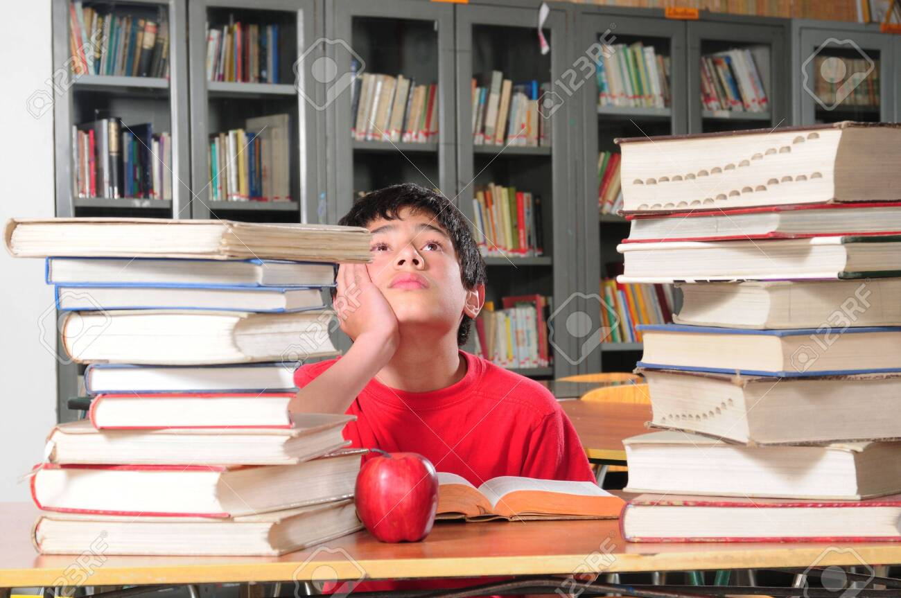 Student in a library. Stock Photo - 5630349
